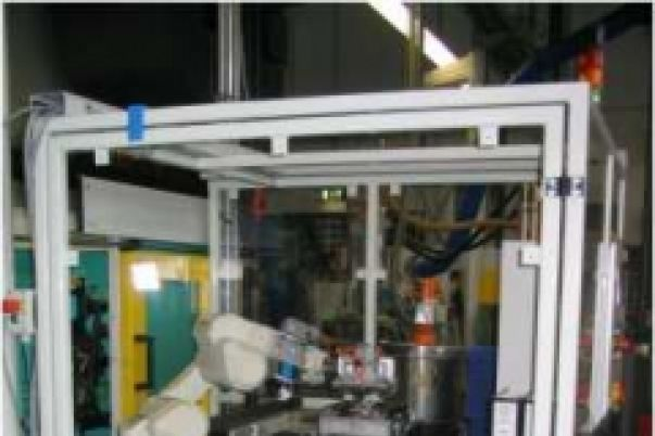 Loading and unloading of an injection moulding machine